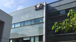 This Thursday, Aug. 25, 2016 file photo shows the logo of the Israeli NSO Group company on a building where they had offices in Herzliya, Israel. (AP Photo/Daniella Cheslow, File)