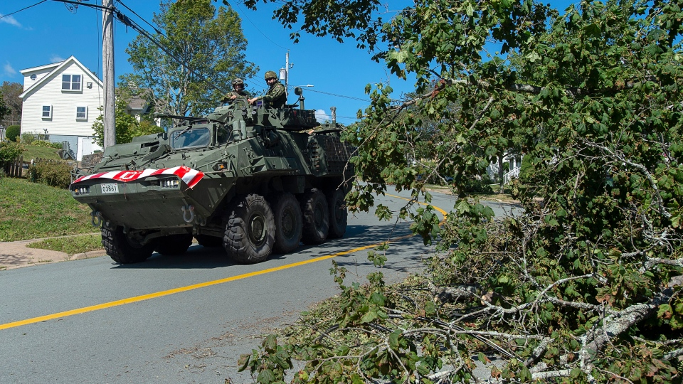 Members of the 4 Engineer Support Regiment from Camp Gagetown assist in the cleanup in Halifax on Monday, Sept. 9, 2019.  (THE CANADIAN PRESS/Andrew Vaughan)