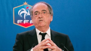 In this file photo, French Football Federation President Noel Le Graet gestures during a press conference in Paris, France. Thursday Dec. 10 2015. The president has been asked to resign by anti-discrimination groups after he called for referees to stop halting games due to homophobic chants. (AP Photo/Jacques Brinon)