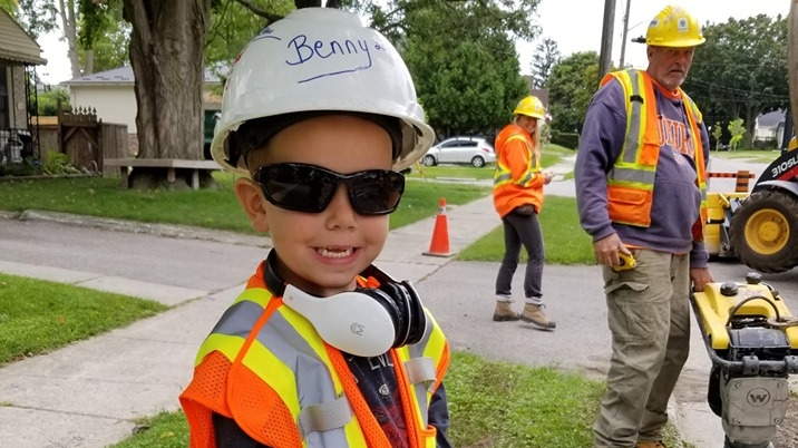 Boy joins city crew