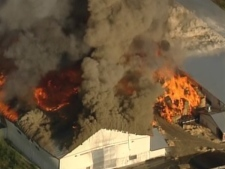 A large barn complex is engulfed in flames in east Langley, B.C. August 27, 2009. (CTV / Chopper 9)