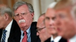 In this April 18, 2018 file photo, National security adviser John Bolton, left, listens to President Donald Trump, far right, speak during a working lunch with Japanese Prime Minister Shinzo Abe at Trump' s private Mar-a-Lago club in Palm Beach, Fla. (AP Photo/Pablo Martinez Monsivais)