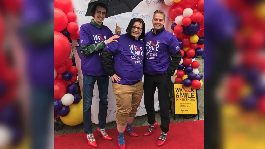 Hundreds gather in red high heels to combat domestic violence