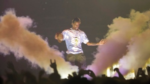 Rapper Travis Scott performs onstage at Capital One Arena on Tuesday, March 12, 2019, in Washington. (Photo by Brent N. Clarke/Invision/AP)