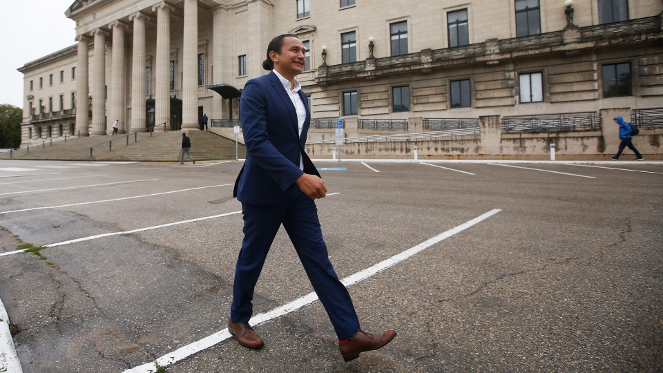 Manitoba NDP leader Wab Kinew leaves after speaking to media on election day outside the Manitoba Legislature in Winnipeg, Tuesday, September 10, 2019. THE CANADIAN PRESS/John Woods