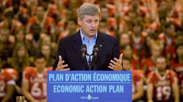 Prime Minister Stephen Harper speaks in front of Laval University athletes as he makes an announcement at Laval University in Quebec City, Thursday, Aug. 27, 2009. Harper defended his decision in a press conference after the announcement. (Jacques Boissinot / THE CANADIAN PRESS)