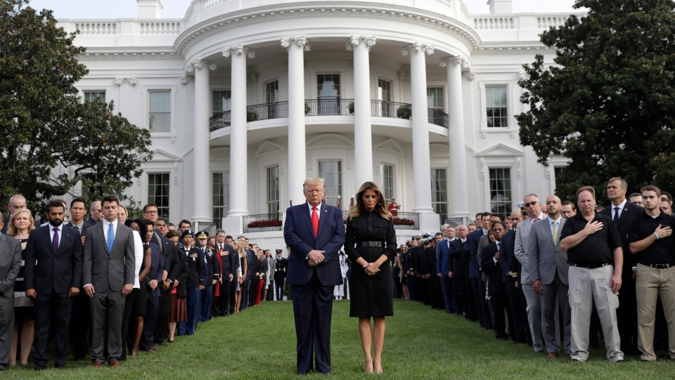 U.S. President Donald Trump and first lady Melania Trump participate in a moment of silence honouring the victims of the Sept. 11 terrorist attacks, on the South Lawn of the White House, Wednesday, Sept. 11, 2019, in Washington. (AP Photo/Evan Vucci)