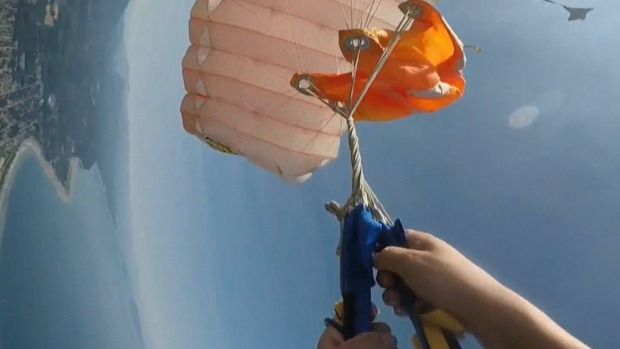 Woman's parachute tangles up in the sky