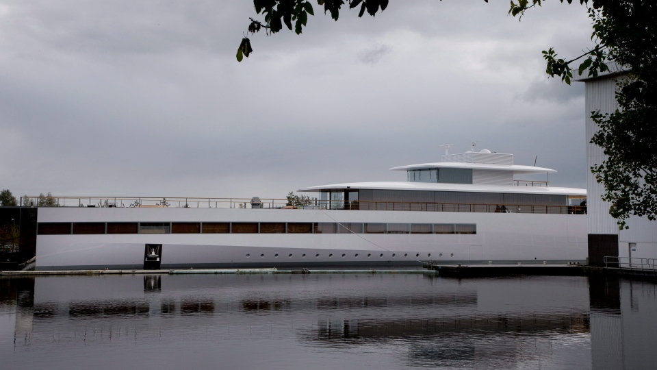 In this Tuesday Oct. 30, 2012 file photo, a yacht is docked at the wharf of ship building company Royal De Vries in Aalsmeer, near Amsterdam, Netherlands. Apple founder Steve Jobs commissioned the sleek, white superyacht before his death. (AP Photo/Peter Dejong, file)