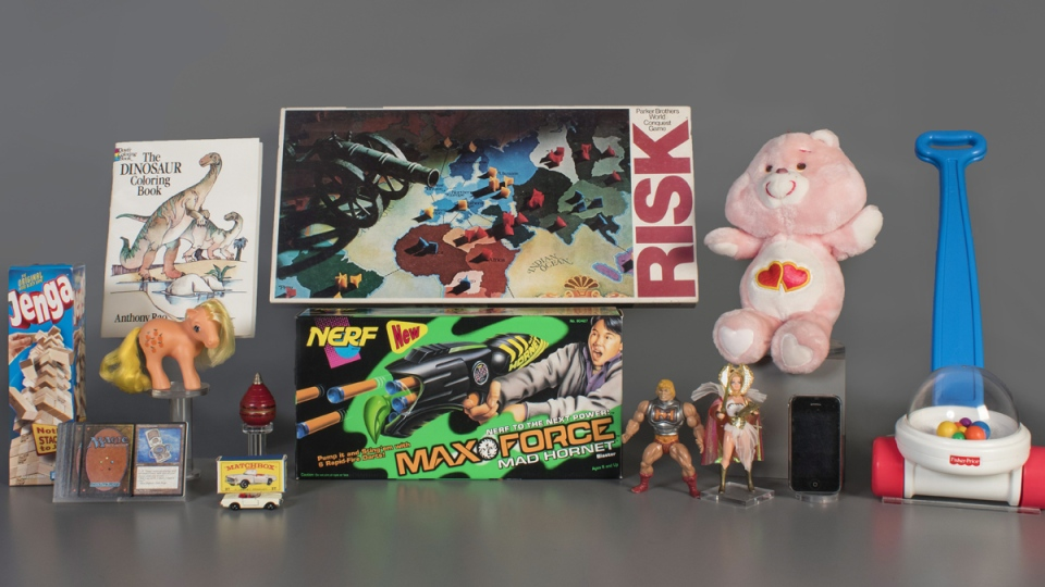 2019 National Toy Hall of Fame finalists, from left to right: Jenga, Magic the Gathering, My Little Pony, Colouring Book, Matchbox Cars, Top, Nerf Blaster, Risk, Masters of the Universe, Care Bears, Smartphone, and Fisher-Price Corn Popper. (National Toy Hall of Fame via AP)