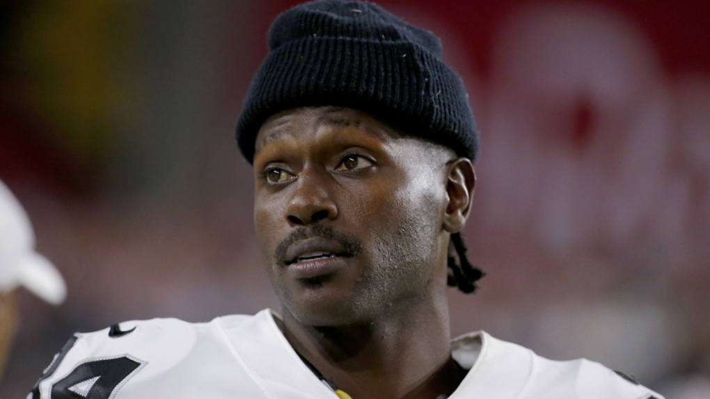 Antonio Brown watches from the sidelines