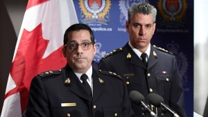 """Supt. Peter Lambertucci, left, Officer in Charge INSET Ottawa, RCMP """"O"""" Division, answers questions from reporters as Chief Supt. Michael LeSage, Criminal Operations Officer looks on, during a press conference, after RCMP charged a youth with terrorism, in Kingston, Ont. on January 25, 2019. (THE CANADIAN PRESS/Justin Tang)"""