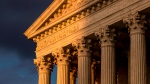 In this Oct. 10, 2017, file photo, the Supreme Court in Washington is seen at sunset. (AP Photo/J. Scott Applewhite, File)