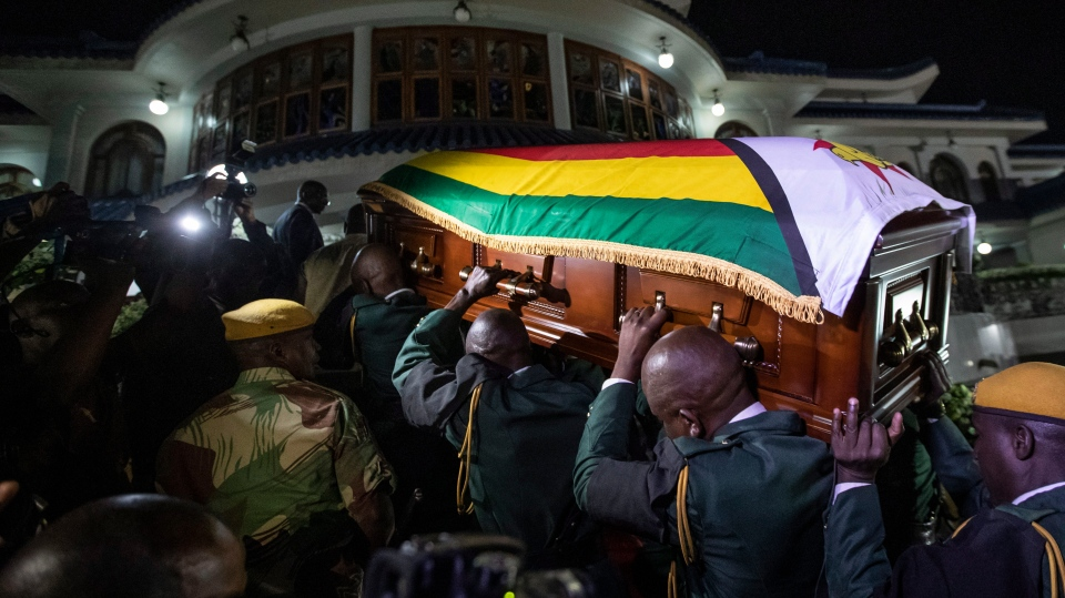 The body of former president Robert Mugabe arrives to lie in state inside his official residence in the capital Harare, Zimbabwe Wednesday, Sept. 11, 2019. (AP Photo/Ben Curtis)