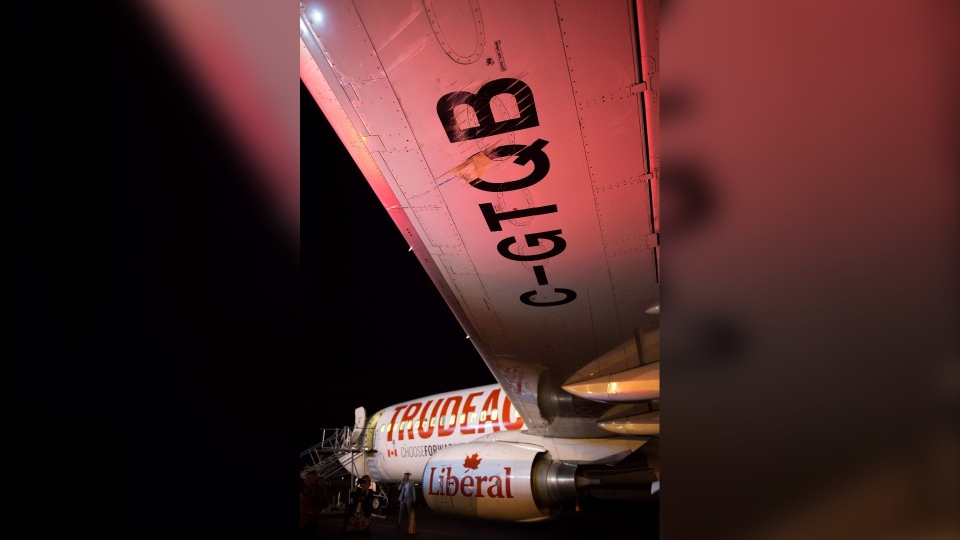 Scrapes are shown on the wing from Liberal Leader Justin Trudeau's campaign plane after being struck by the media bus following landing in Victoria, B.C., on Wednesday, Sept.11, 2019. THE CANADIAN PRESS/Sean Kilpatrick