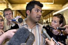 MP Rahim Jaffer, the national caucus chairman reacts to the eviction of journalists by plain-clothes RCMP officers from the lobby of the Charlottetown hotel where the federal Conservative caucus is holding its annual meeting. (CP / Jacques Boissinot)