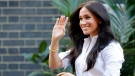Meghan, the Duchess of Sussex, waves as she leaves a department store after launching the Smart Works capsule collection in London, Thursday, Sept. 12, 2019. (AP Photo/Frank Augstein)