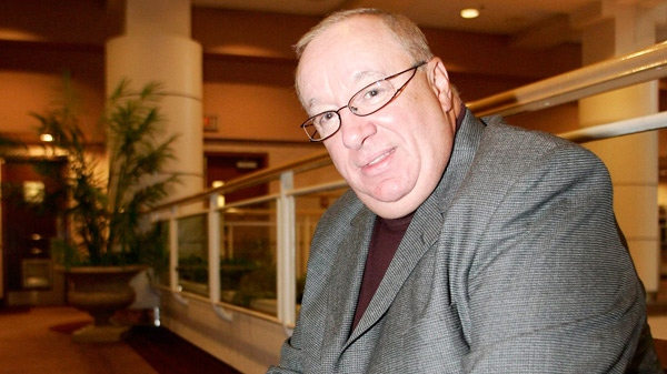 Former NHL coach Jacques Demers holds onto a pamphlet promoting family reading prior to taking park in a panel on literacy in Vancouver, Thursday, September 27, 2007. (Richard Lam / THE CANADIAN PRESS)