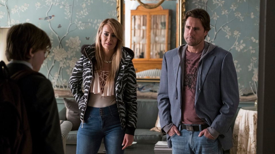"This image released by Warner Bros. Pictures shows Oakes Fegley, from left, Sarah Paulson and Luke Wilson in a scene from ""The Goldfinch,"" in theaters on Sept. 13. (Macall Polay/Warner Bros. Pictures via AP)"