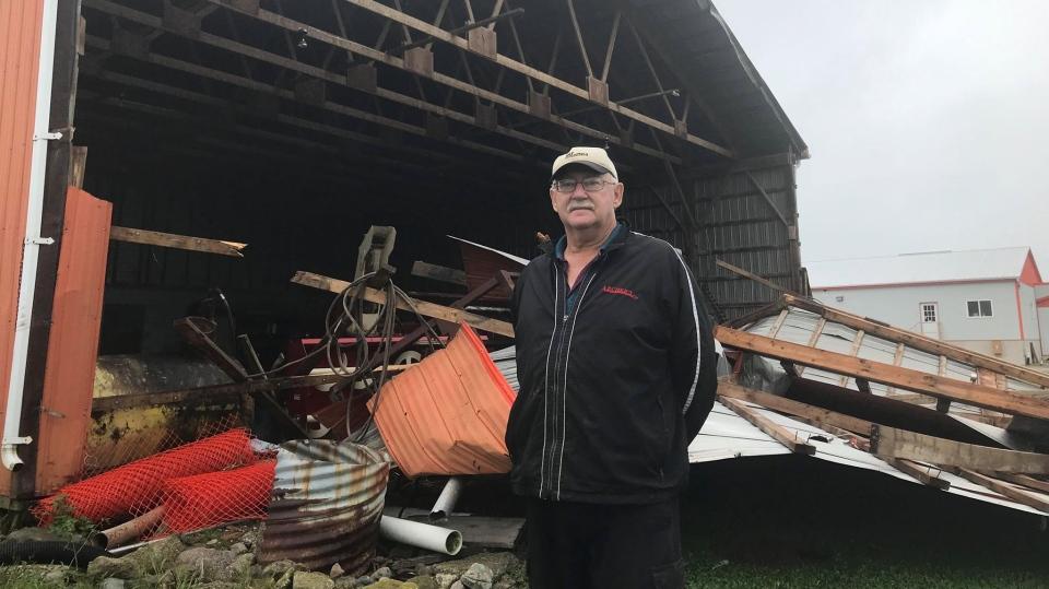 Doug Krall surveys the storm damage to his service barn in the Petrolia, Ont. area on Thursday, Sept. 12, 2019. (Sean Irvine / CTV London)