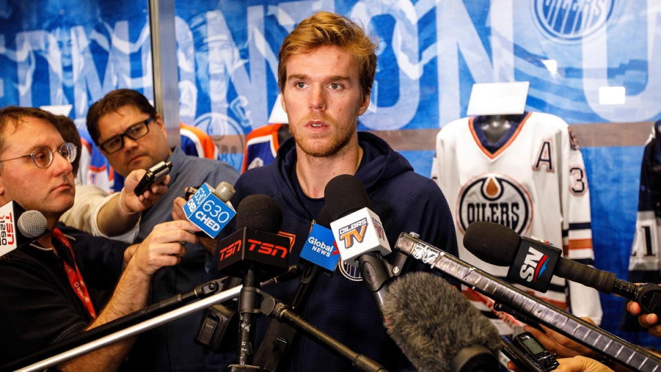 Edmonton Oilers Connor McDavid speaks to media during the Edmonton Oilers training camp in Edmonton on Thursday September 12, 2019. THE CANADIAN PRESS/Jason Franson
