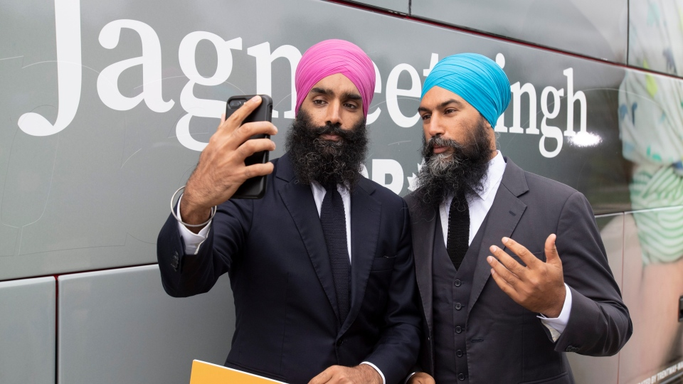 NDP leader Jagmeet Singh and his brother Gurratan Singh record a video for social media following a campaign stop in Brampton, Ont., Thursday September 12, 2019. THE CANADIAN PRESS/Adrian Wyld