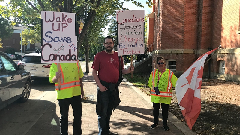 Protesters holding signs and wearing yellow vests turned out in advance of an Edmonton campaign event held by Liberal Leader Justin Trudeau Thursday, Sept. 12, 2019. (CTV News Edmonton)