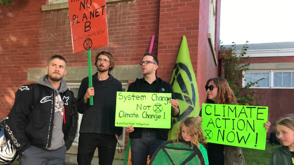 Several protesters from the environmental advocacy group Extinction Rebellion were also present at the campaign event. Sept. 12, 2019. (CTV News Edmonton)