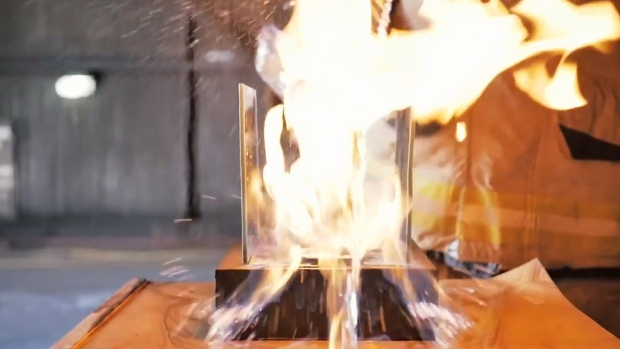 """A video still captures the """"flame-jetting"""" that can occur when refueling portable firepot burners improperly."""