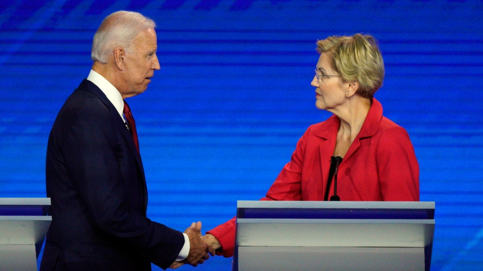 Democratic presidential candidates former Vice President Joe Biden, left, and Sen. Elizabeth Warren, D-Mass., shake hands Thursday, Sept. 12, 2019, after a Democratic presidential primary debate at Texas Southern University in Houston. (AP Photo/David J. Phillip)