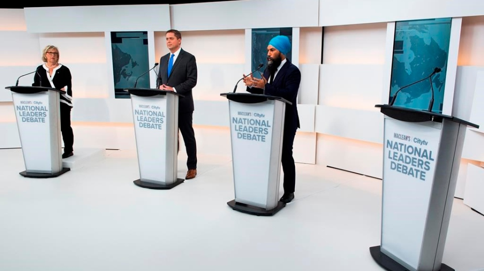 A empty podium stand where Liberal Leader Justin Trudeau turned down the invitation for the debate as Green Party Leader Elizabeth May, left, Conservative Leader Andrew Scheer, centre, and NDP Leader Jagmeet Singh take part during the Maclean's/Citytv National Leaders Debate in Toronto on Thursday, September 12, 2019. THE CANADIAN PRESS/Frank Gunn