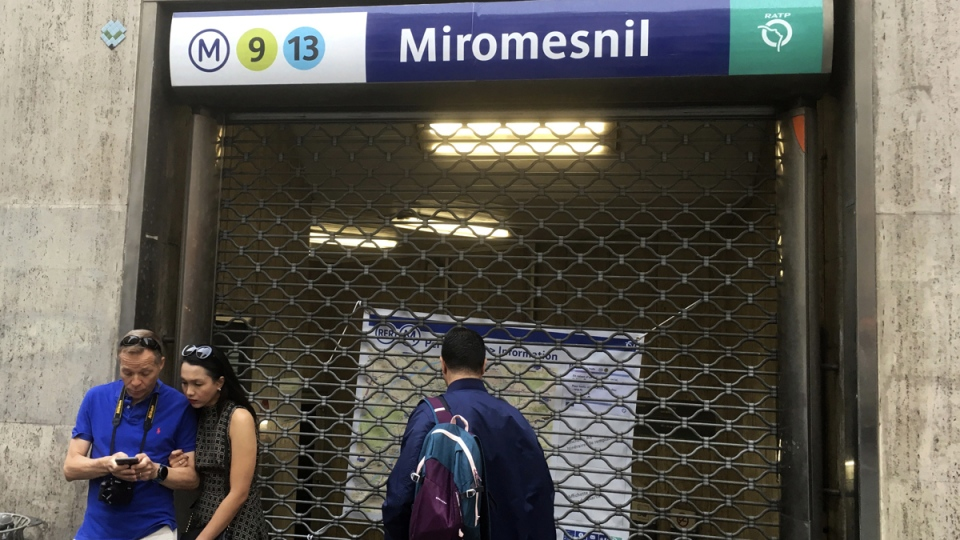 People stand by a closed metro station on Sept.13, 2019 in Paris. (Bertrand Combaldieu / AP)