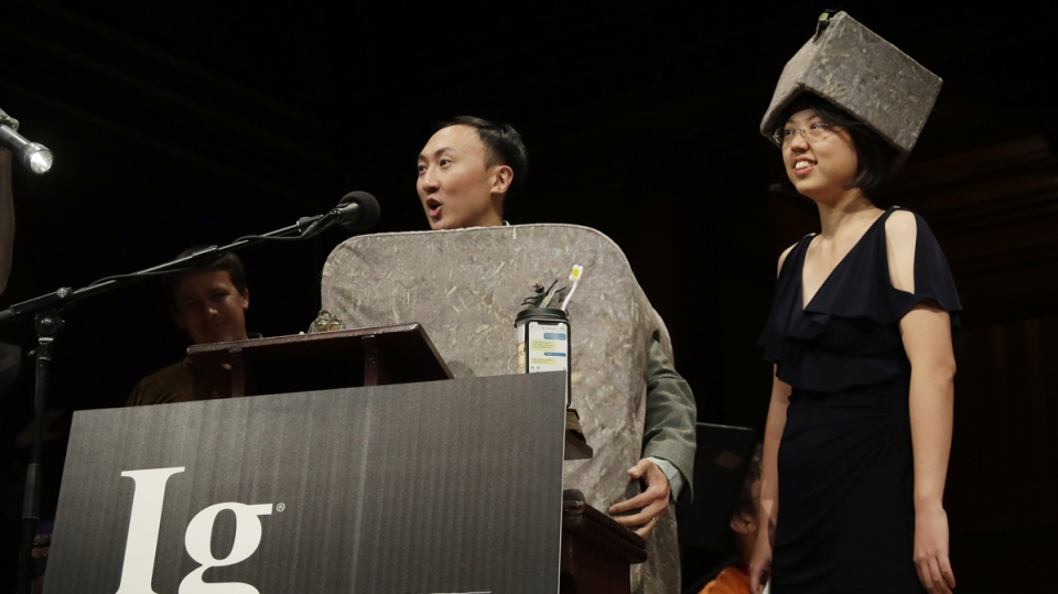 David Hu and Patricia Yang receive the Ig Nobel award in physics for studying how and why wombats make cubed poo, at the 29th annual Ig Nobel awards ceremony on Sept. 12, 2019. (Elise Amendola / AP)