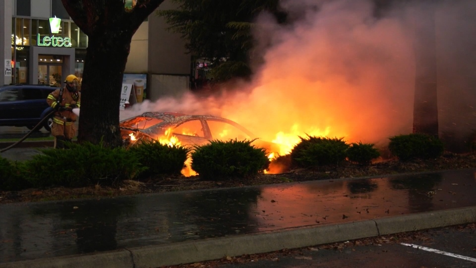 A car was engulfed by flames on the side of a busy Richmond road Thursday.
