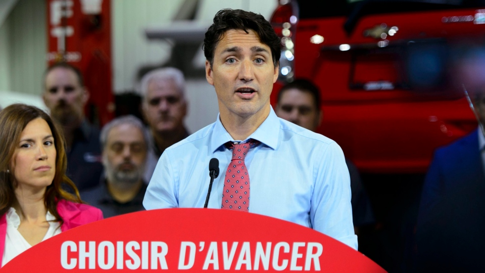 Liberal Leader Justin Trudeau makes a policy announcement and holds a media availability at an electric vehicle car dealership during a campaign stop in Trois-Rivieres, Que., on Friday, Sept. 13, 2019. THE CANADIAN PRESS/Sean Kilpatrick