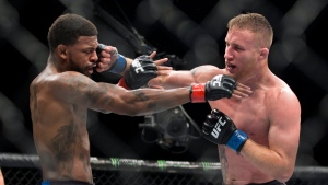 Michael Johnson, left, is hit by Justin Gaethje in a UFC lightweight mixed martial arts bout in Las Vegas, Friday, July 7, 2017. (Erik Verduzco/Las Vegas Review-Journal via AP)