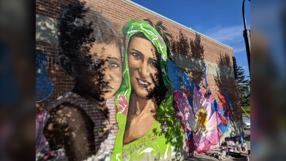 The mural outside the Sunalta LRT Station is of Kirpal Kaur Dhindsa, holding a child.
