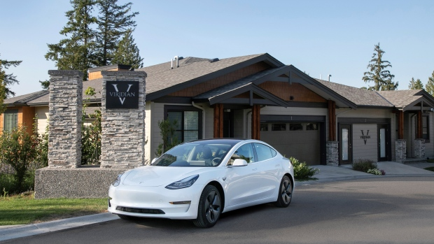 The Teslas being offered are valued at $55,000. The promotion will be available starting Saturday, and it will continue until Oct. 31 or until the final 10 units in the development are sold. (Century Group)