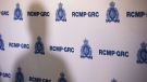 An RCMP backdrop during a press conference. THE CANADIAN PRESS/John Woods