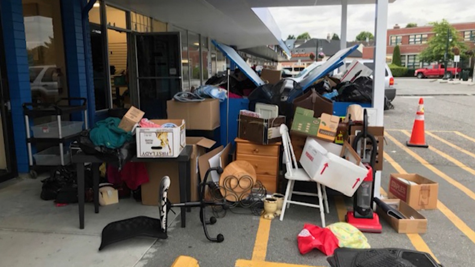 Overnight donations pile up outside the Delta Hospital Auxiliary Thrift Store, and some people are rooting through the treasures before volunteers get a chance.