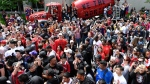 In this file photo, fans cheer as they celebrate during the 2019 Toronto Raptors Championship parade in Toronto on Monday, June 17, 2019. THE CANADIAN PRESS/Frank Gunn