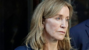 Felicity Huffman leaves federal court after her sentencing in a nationwide college admissions bribery scandal, Friday, Sept. 13, 2019, in Boston. (AP / Elise Amendola)