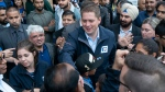 Conservative Leader Andrew Scheer makes his way through a crowd of supporters during a campaign stop in Brampton, Ont. on Friday, September 13, 2019. THE CANADIAN PRESS/Paul Chiasson