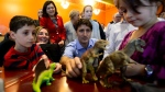 Liberal Leader Justin Trudeau and daughter Ella Grace Trudeau, back centre right, meet children as they make a whistle stop in Mascouche, Que., on Saturday, Sept. 14, 2019. THE CANADIAN PRESS/Sean Kilpatrick