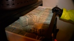 This photo provided by the U.S. Attorneys Office for Utah and introduced as evidence at the Aaron Shamo trial shows money found in Aaron Shamo's home. Shamo was convicted of running a multimillion-dollar fentanyl trafficking empire from his basement in suburban Salt Lake City in a case that offers an unprecedented window into how fentanyl bought and sold online has transformed the global drug trade. (U.S. Attorney's Office, Utah, via AP)