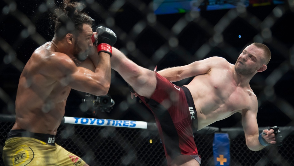 Welterweight fighters Michel Pereira, left, fights Tristan Connelly during UFC Fight Night at Rogers Arena in Vancouver, Saturday, September, 14, 2019. THE CANADIAN PRESS/Jonathan Hayward