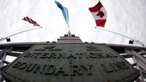 The International Boundary Line between the United States and Canada is shown on the Peace Bridge in Buffalo, N.Y., Monday June 1, 2009. (AP Photo/David Duprey)