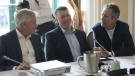 Manitoba Premier Brian Pallister, right to left, P.E.I. Premier Dennis King and Newfoundland and Labrador Premier Dwight Ball talk among themselves during a meeting of Canada's Premiers in Saskatoon, Sask. Wednesday, July 10, 2019. Prince Edward Island is rolling out a provincial disaster assistance program next week as residents rebuild from post-tropical storm Dorian, which struck the island earlier this month. THE CANADIAN PRESS/Jonathan Hayward