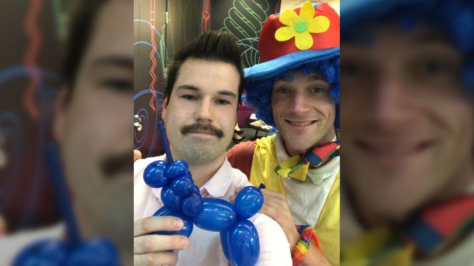 Joshua Jack and his emotional support clown Joe pose with a balloon unicorn made during the meeting. (Courtesy Joshua Jack)