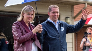 Federal Conservative leader Andrew Scheer and his wife Jill leave a campaign announcement in Surrey, B.C. on Sunday, September 15, 2019. THE CANADIAN PRESS/Frank Gunn